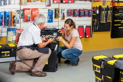 Salesman Showing Tools To Customer In Shop Stock Photo
