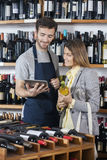 Salesman Showing Wine Information To Customer On Digital Tablet Stock Images