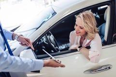 Salesman showing woman something on digital tablet stock image