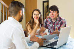 Salesman sign contract with couple Stock Photos