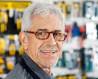 Salesman Smiling In Hardware Store. Closeup portrait of senior salesman smiling in hardware store Royalty Free Stock Image