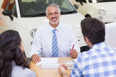 Salesman speaking with his clients Royalty Free Stock Images