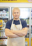 Salesman Standing With Arms Crossed In Grocery Store Stock Photos