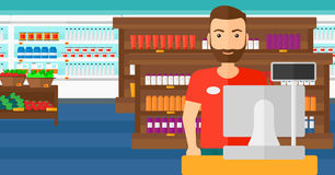 Salesman standing  at checkout. Royalty Free Stock Photo