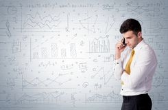 Salesman standing with drawn graph charts Royalty Free Stock Photos