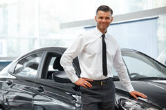 Salesman Stands Near Brand New Car. Car Showroom Stock Photos