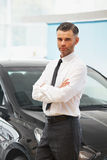 Salesman Stands Near Brand New Car. Car Showroom Royalty Free Stock Image