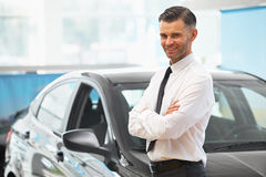 Salesman Stands Near Brand New Car. Car Showroom Royalty Free Stock Images
