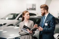 Salesman in suit showing catalog to customer Royalty Free Stock Photo
