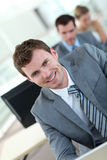 Salesman in suit in training. Salesman in grey suit attending business training Stock Images