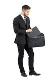 Salesman taking document folder out of briefcase Royalty Free Stock Photo