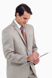 Salesman taking notes. Against a white background Royalty Free Stock Images