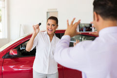 Salesman taking picture customer Stock Photo