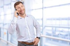 Salesman talking on mobile phone. Handsome salesman talking on mobile phone royalty free stock image
