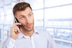 Salesman talking on mobile phone. Handsome salesman talking on mobile phone stock photo