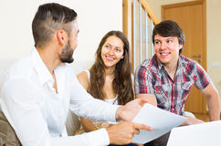 Salesman try to sign contract with couple Stock Photos