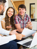 Salesman try to sign contract with couple Royalty Free Stock Images