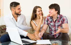 Salesman try to sign contract with couple Royalty Free Stock Image