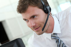 Salesman using headset working at office. Portrait of salesman with headset on Royalty Free Stock Photos