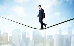 Free Salesman Walking On Rope Above The City Royalty Free Stock Photography - 75804707