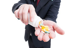 Salesman wearing suit and handing, giving offering pills Stock Photos