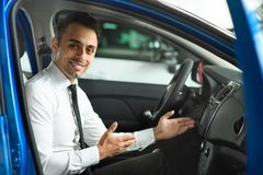 Sales man is sitting in new car royalty free stock photo