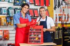 Salesmen Showing Drill Bits In Shop Royalty Free Stock Photos