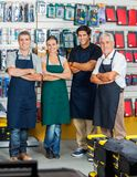 Salespeople Smiling In Hardware Store Royalty Free Stock Photo