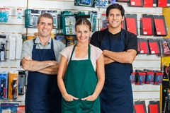 Salespeople Standing In Hardware Store. Portrait of confident salespeople standing in hardware store Stock Image