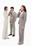 Salespeople on their phones Royalty Free Stock Image