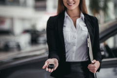 Salesperson at car dealership. Cropped image of professional female salesperson at car dealership stock photography