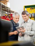 Salesperson And Customer Using Digital Tablet. In hardware store Royalty Free Stock Photography