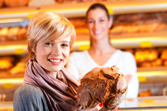 Salesperson with female customer in bakery Stock Photo