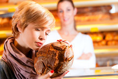 Salesperson with female customer in bakery Royalty Free Stock Photos