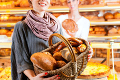 Salesperson with female customer in bakery Stock Photos