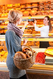 Salesperson with female customer in bakery Royalty Free Stock Photography