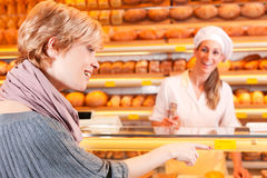 Salesperson with female customer in bakery Stock Photography