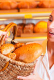 Salesperson with female customer in bakery Royalty Free Stock Image