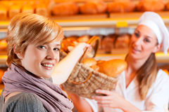 Salesperson with female customer in bakery Stock Image