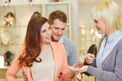 Salesperson showing bracelet Stock Image