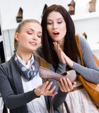 Salesperson shows footwear to the customer Stock Images