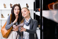 Salesperson shows pumps to the customer Stock Image