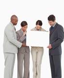 Salesteam держа пустой знак совместно Стоковые Изображения