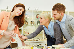 Saleswoman advising custormers Stock Photography