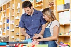 Saleswoman Assisting Customer In Choosing Greeting Stock Images