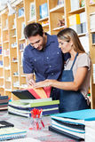 Saleswoman Assisting Male Customer To Choose Stock Image
