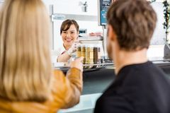 Saleswoman Attending Customers At Butcher's Shop Stock Images