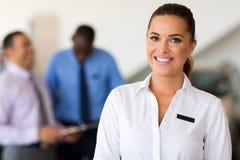 Saleswoman car dealership Stock Image