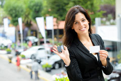 Saleswoman with car keys in trade fair stock images