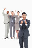 Saleswoman with cheering team behind her Stock Photos